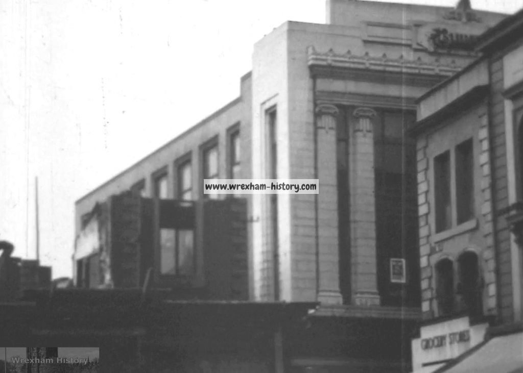 burtons-from-high-street-with-part-demolished-town-hall-1940-2