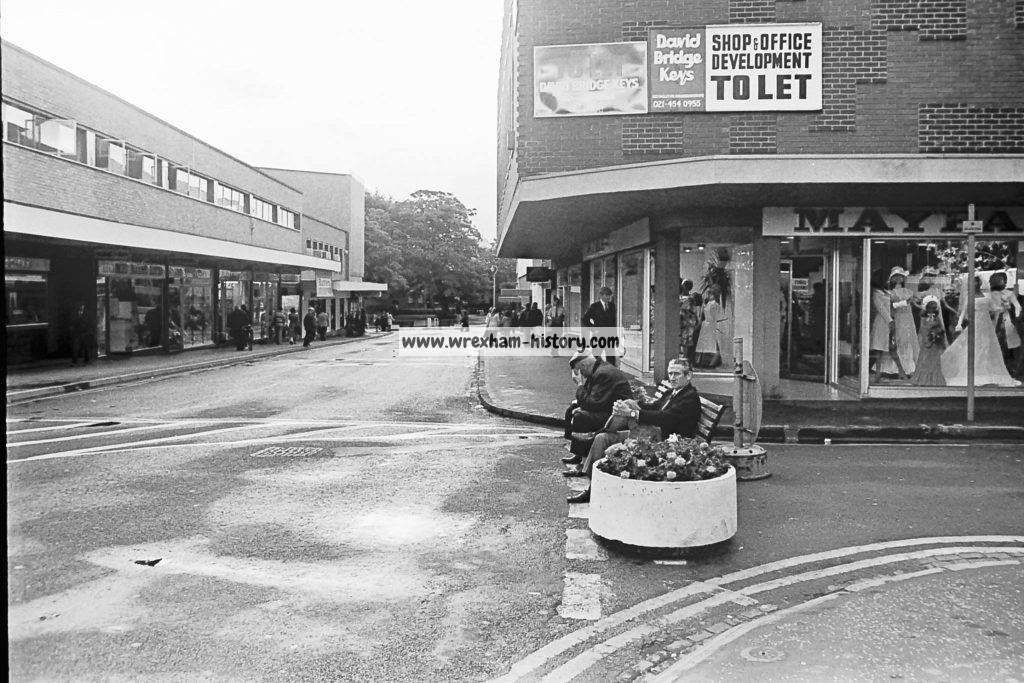 Relaxing on a bench in Lord Street Wrexham, 1975